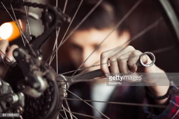 Focused On Repairing Bicycle Tire