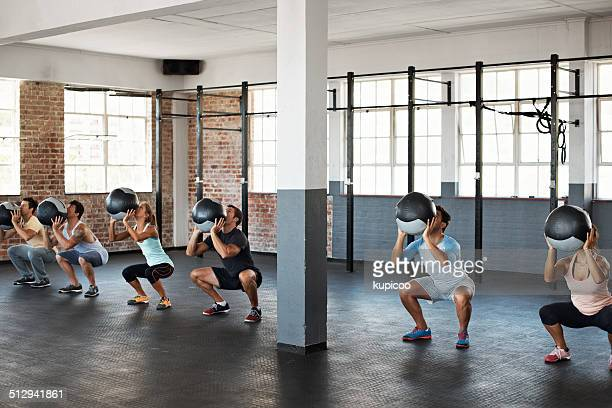 focused on the throw - circuit training stock photos and pictures