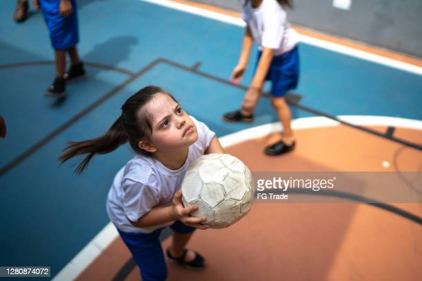 focused student with disability playing basketball - basketball sport stock pictures, royalty-free photos & images