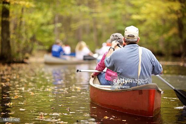 Focused view of senior pair paddling a canoe