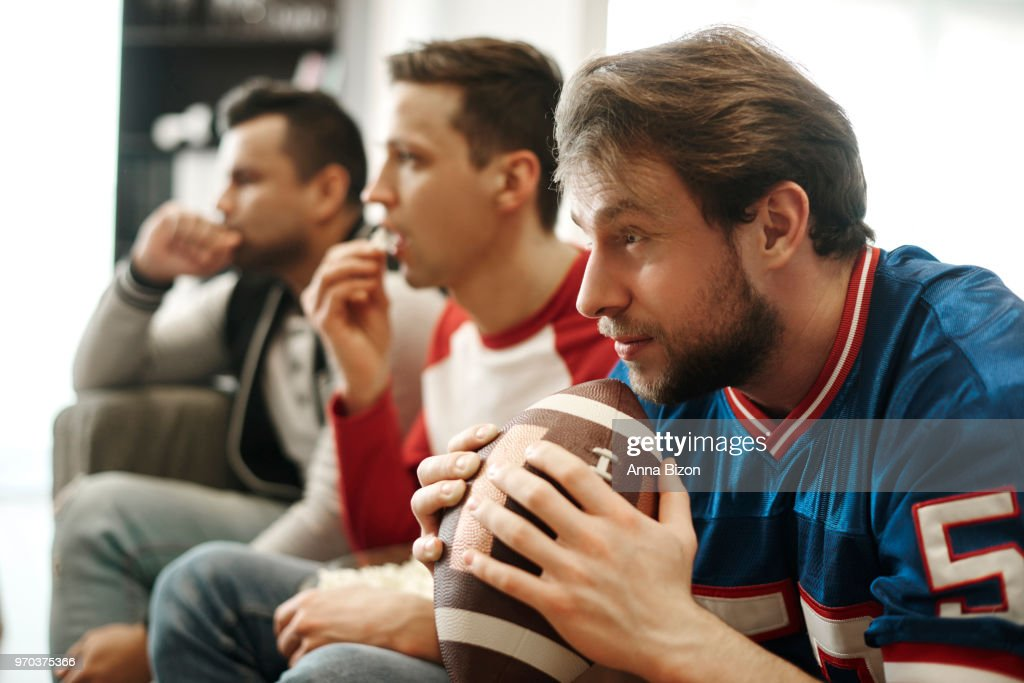 Focused watching football game at home. Debica, Poland : Stock Photo