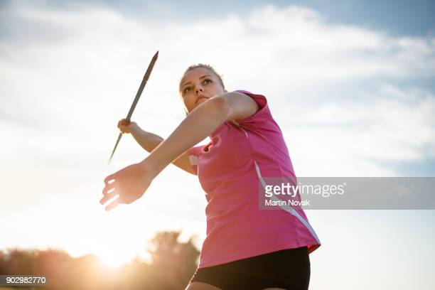 focused - woman throwing javelin - shooting at goal stock pictures, royalty-free photos & images