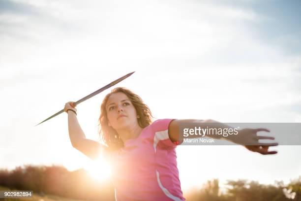 Focused - woman throwing javelin