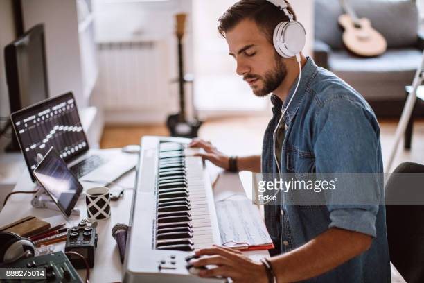 focused young artist playing electric piano - sound recording equipment stock pictures, royalty-free photos & images
