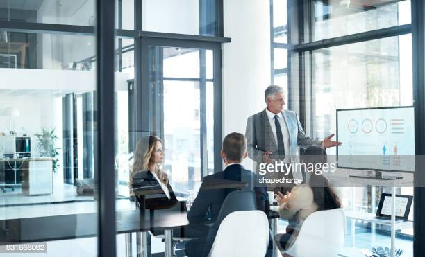 focusing their attention - corporate business stock pictures, royalty-free photos & images