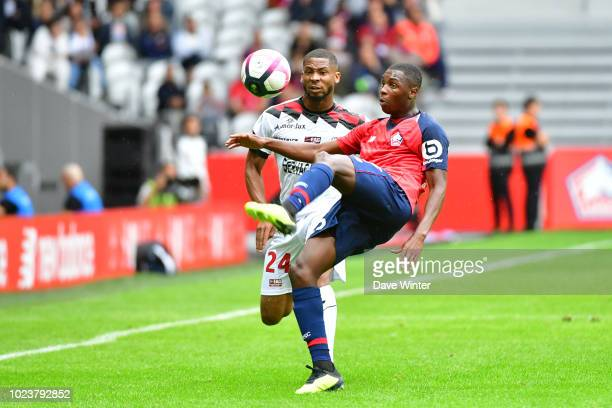 Fode Ballo Toure of Lille and Marcus Coco of Guingamp during the Ligue 1 match between Lille and Guingamp on August 26, 2018 in Lille, France.