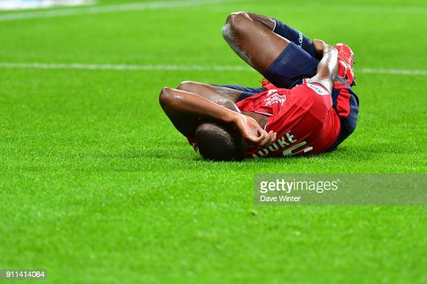 Fode Ballo Toure of Lille goes down injured during the Ligue 1 match between Lille OSC and Strasbourg at Stade Pierre Mauroy on January 28 2018 in...