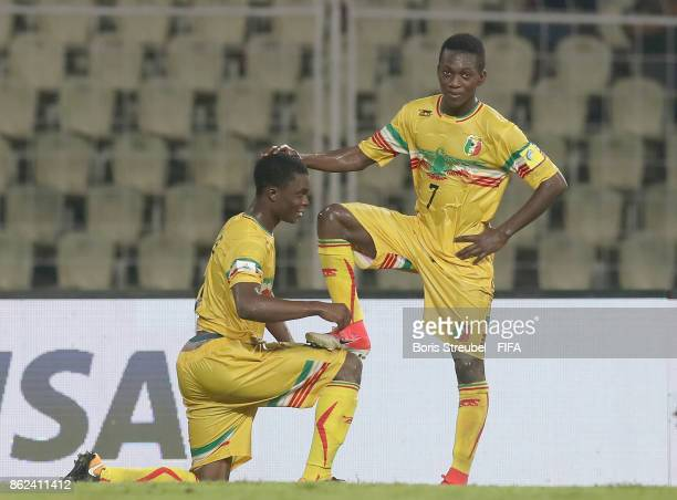 Fode Konate of Mali celebrates with team mate Hadji Drame of Mali after scoring his team's third goal during the FIFA U17 World Cup India 2017 Round...