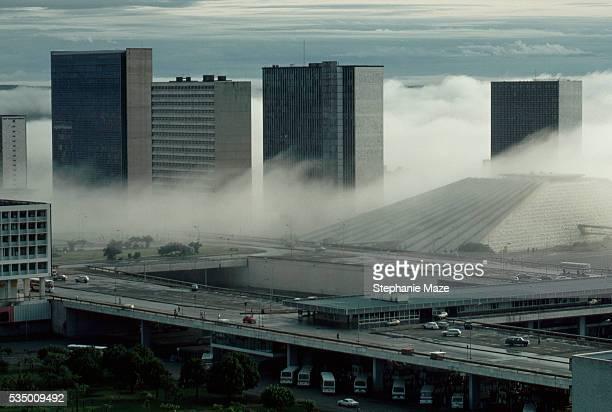 fog and downtown buildings in brasilia - ブラジリア ストックフォトと画像