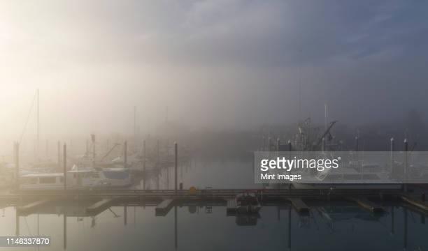 fog at boat harbor - norden stock-fotos und bilder