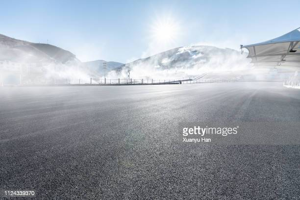 fog covered road - paved driveway stock pictures, royalty-free photos & images