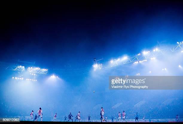 Fog from lighting flares stands over stadium during the Superleague Greece match between Olympiacos Piraeus and PAOK at Karaiskaki stadium on...
