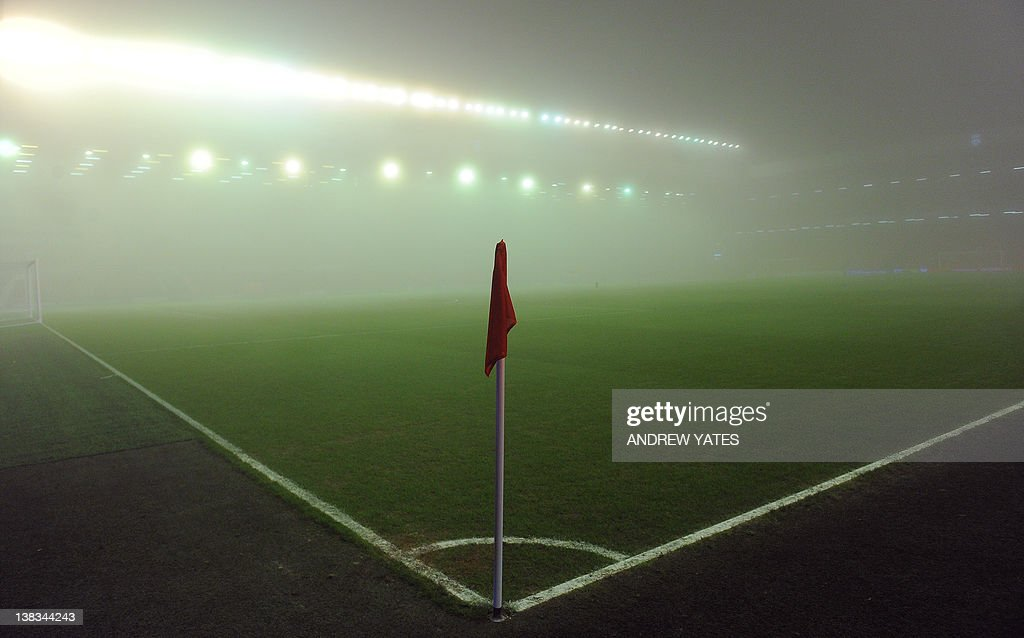 Fog gathers in the stadium prior to the : News Photo