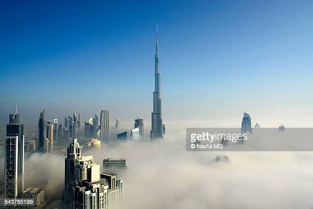 fog in dubai - skyscraper stock pictures, royalty-free photos & images