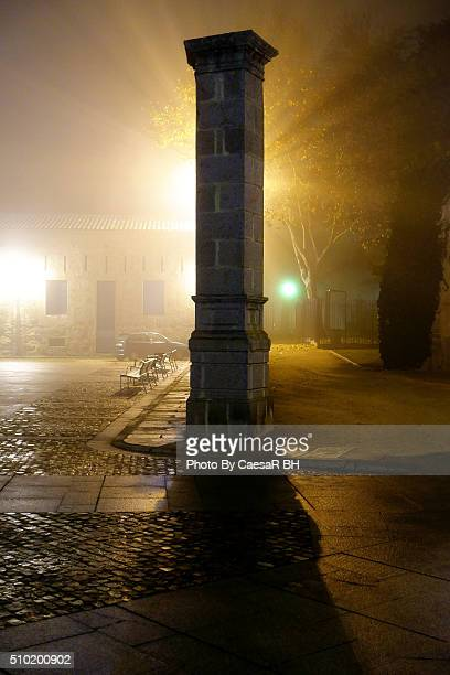 fog in the city. old ruins under the fog, a mistery in the time. - mistery foto e immagini stock