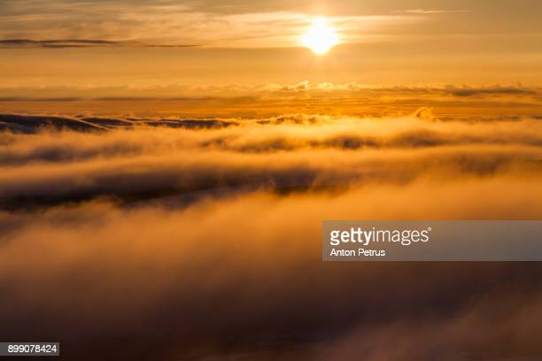 Fog in the mountains at sunset. Norway, Finnmark