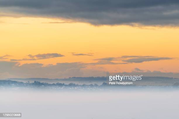 fog inversion during sunset - lancashire stock pictures, royalty-free photos & images