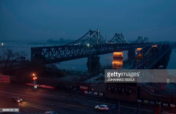 Fog is seen over the Friendship and the Broken bridges over the Yalu River connecting the North Korean town of Sinuiju and Dandong in Chinese border...