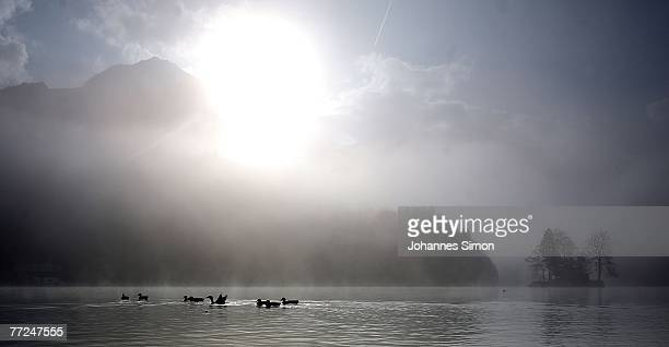 Fog lifts up in the early morning over Koenigssee Lake in the Bavarian Alps on October 10 2007 in Schoenau am Koenigssee Weather forecasts predict...