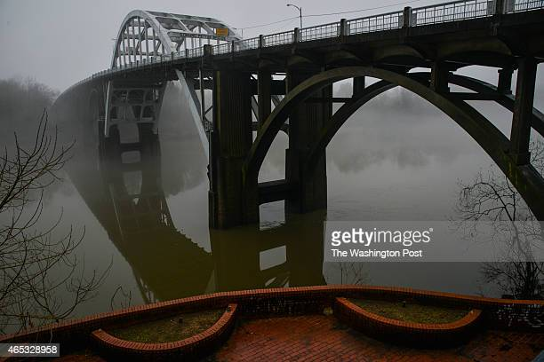 Fog lingers over the historic Edmund Pettus Bridge on Tuesday, March 3 in Selma, AL. This coming weekend marks the 50th anniversary of Bloody Sunday,...