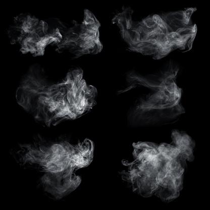 Fog or smoke set isolated on black background. White cloudiness, mist or smog background. 1046062504