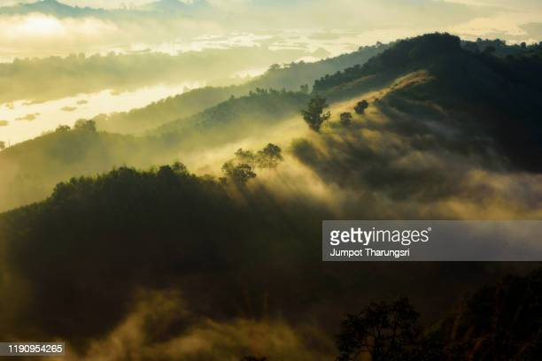 fog over high mountain - atmospheric mood stock pictures, royalty-free photos & images