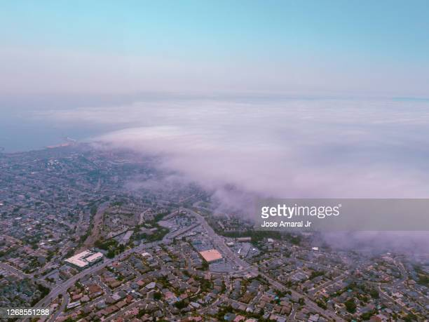 fog over the bay - sloppy joe, jr stock pictures, royalty-free photos & images