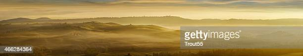 Fog over the hills of Tuscany at sunset