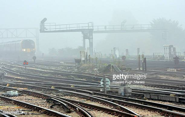 fog over the railway tracks - howard pugh stock pictures, royalty-free photos & images