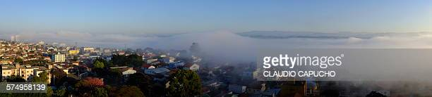 fog panorama - claudio capucho stock photos and pictures