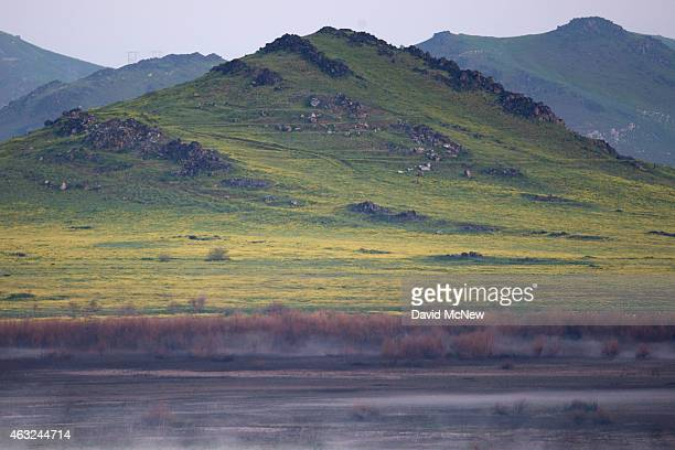 Fog rise from a dry section of Lake Success as rain totals remain insufficient to break the worsening drought on February 11, 2015 near East...