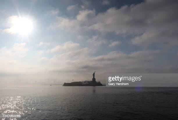 Fog rises off the waters around Liberty Island and the Statue of Liberty at sunrise on June 6, 2020 in Jersey City, New Jersey.