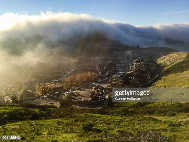fog rolling in - gunnar helliesen stock pictures, royalty-free photos & images