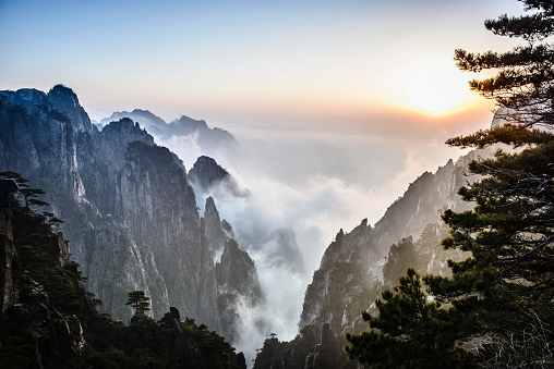 Fog rolling over rocky mountains, Huangshan, Anhui, China - gettyimageskorea