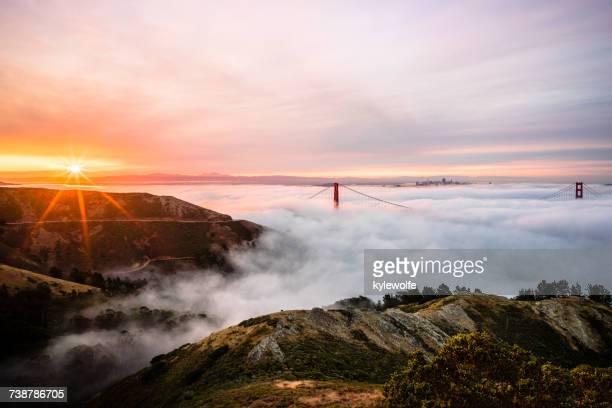Fog Rolling Over the Golden Gate Bridge at Sunrise, San Francisco, California, America, USA