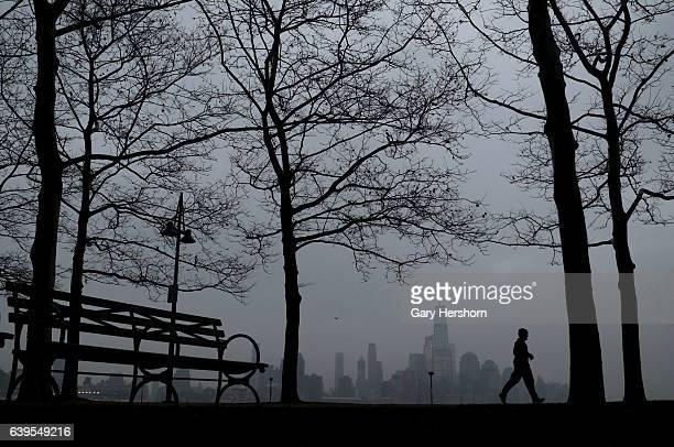 Fog settle in over lower Manhattan and One World Trade Center in New York City on January 22, 2017 as seen from Hoboken, NJ.