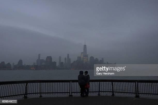 Fog settles in over lower Manhattan and One World Trade Center in New York City on January 22, 2017 as seen from Hoboken, NJ.