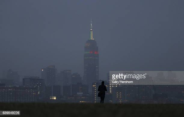 Fog settles in over midtown Manhattan and the Empire State Building lit for the teams playing in the NFC Championship in New York City on January 22,...
