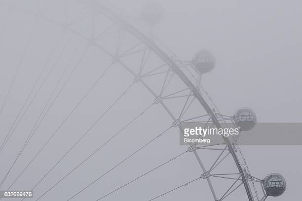 Fog shrouds pods of the London Eye in London UK on Wednesday Jan 25 2017 UK Prime Minister Theresa May said she'll publish her plan for Brexit giving...