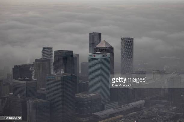 Fog shrouds the Canary Wharf business district including global financial institutions Citigroup Inc., State Street Corp., Barclays Plc, HSBC...