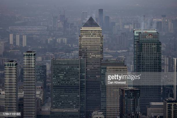 Fog shrouds the Canary Wharf business district including global financial institutions Citigroup Inc State Street Corp Barclays Plc HSBC Holdings Plc...