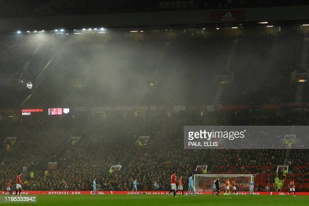 Fog shrouds the pitch during the English Premier League football match between Manchester United and Burnley at Old Trafford in Manchester north west...