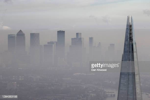 Fog shrouds the Shard and the view towards the Canary Wharf business district including global financial institutions Citigroup Inc., State Street...