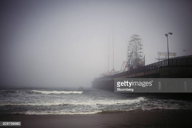 Fog surrounds the Steel Pier amusement center in Atlantic City New Jersey US on Monday May 2 2016 Atlantic City made $18 million in interest payments...