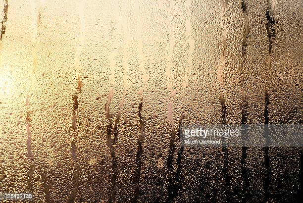 fogged window with water dripping down