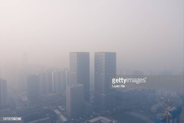 foggy city aerial view - environmental damage stock pictures, royalty-free photos & images