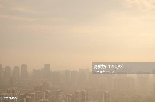 foggy city - beijing smog stock pictures, royalty-free photos & images