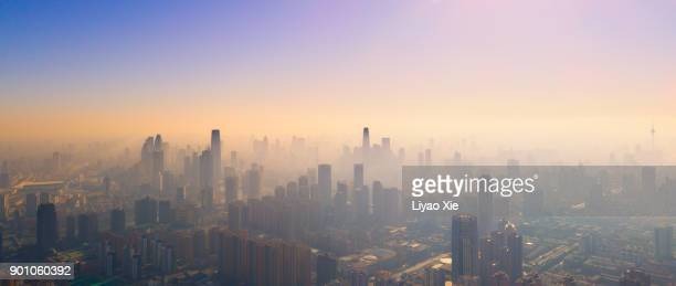 foggy city - pollution stock pictures, royalty-free photos & images