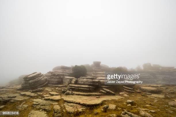 a foggy day at el torcal de antequera. - paraje natural torcal de antequera fotografías e imágenes de stock