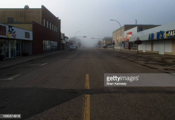 foggy downtown westlock alberta - town stock pictures, royalty-free photos & images